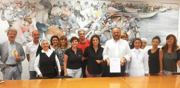 La foto della firma del protocollo