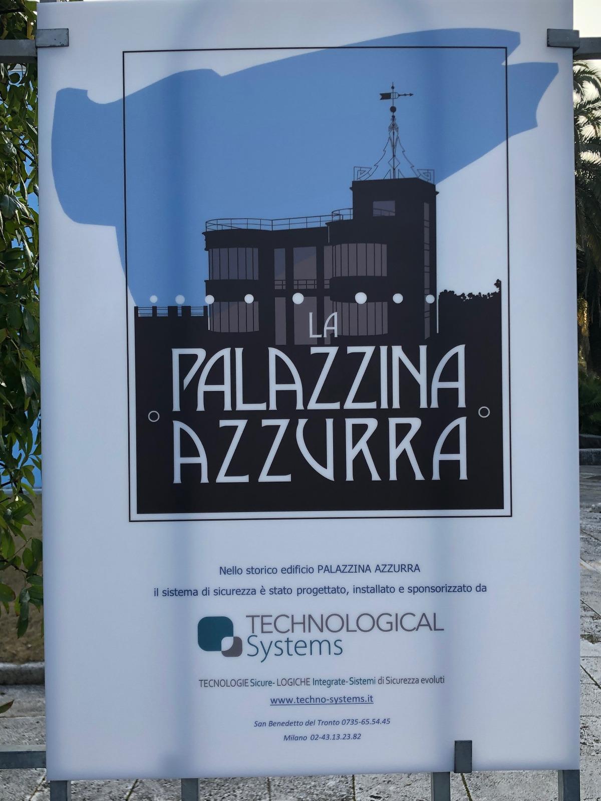 Il nuovo logo della Palazzina riprodotto all'ingresso dell'edificio